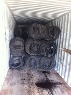 baled tyres in container